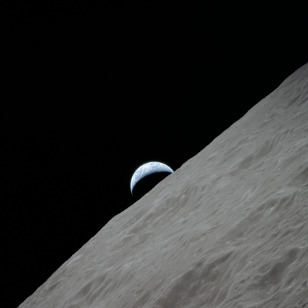 View of the crescent Earth rising above the lunar horizon over the Ritz Crater. Image taken during the Apollo 17 mission on Revolution 66. Original film magazine was labeled PP. Film type was SO-368 Color Ektachrome MS CEX,Color Reversal, 250mm lens., Longitude 98.2 East, Azimuth 264, Altitude 113 km. NASA Identifier: as17-152-23274